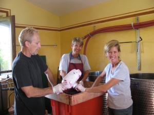 Steve, Inga & Susan pressing grapes