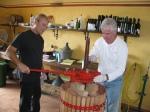 Steve & Rob operating the wine press